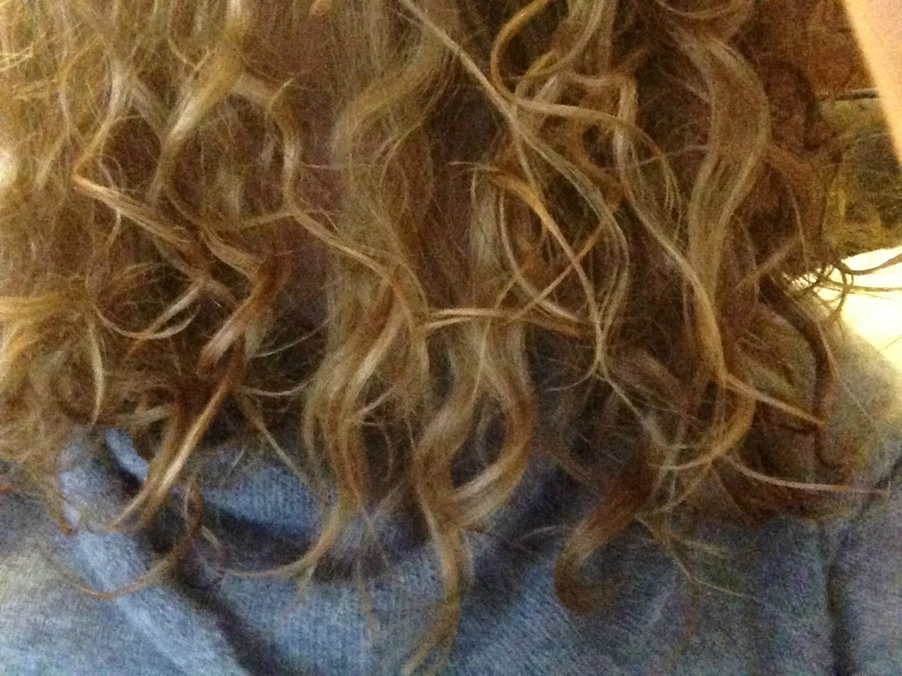 The ends of my very curly blonde hair