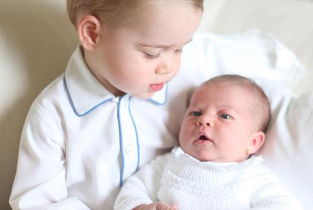 First photos of Princess Charlotte of Cambridge with Prince George